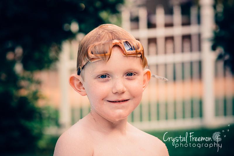Six year old boy wearing swim goggles
