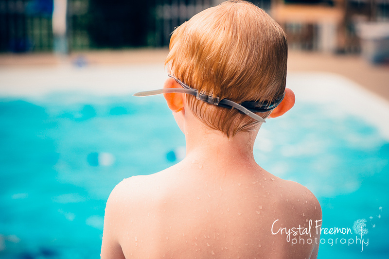 Back of six year old boy about to jump in pool