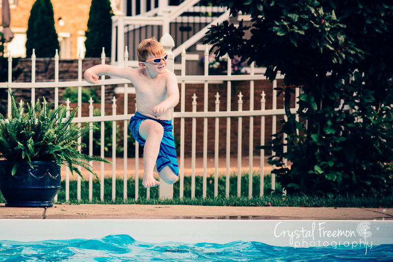 Six year old boy jumping into pool.