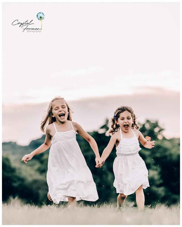 Joyful, playful sisters running at Aspen Grove Park in Franklin TN