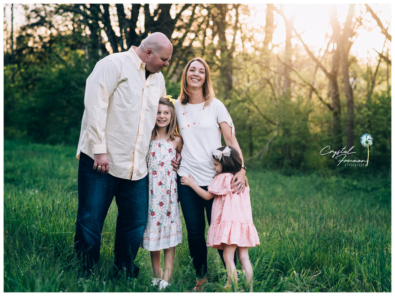 Family of Four outdoor spring photo session with two sisters