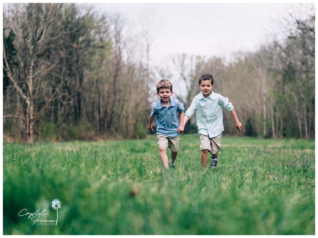 Family of four with two brothers outdoor spring portrait session in Spring Hill TN
